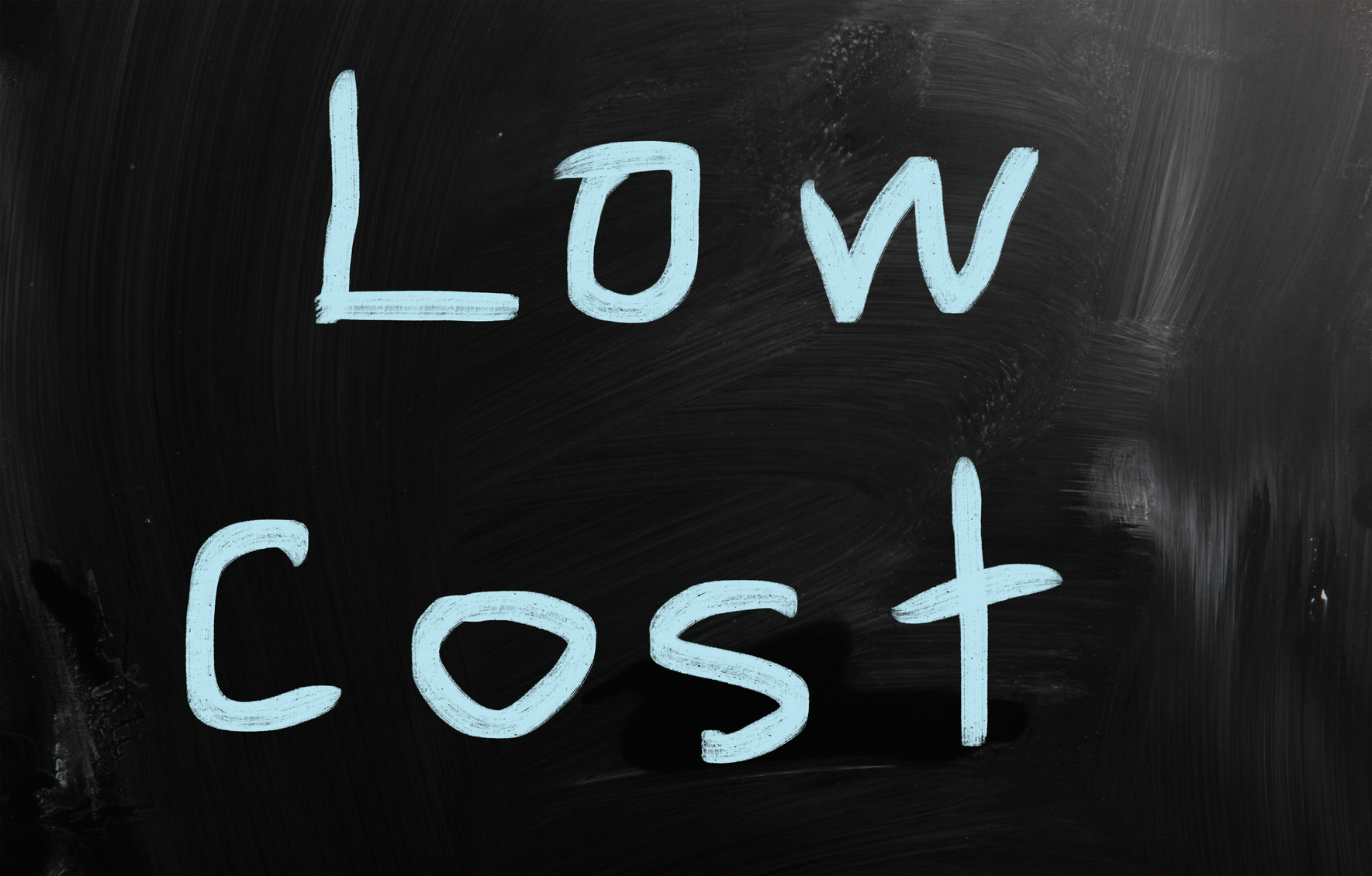 """Low cost"" handwritten with white chalk on a blackboard"